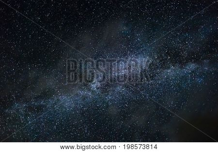 Milky Way galaxy and bright stars in dark night sky light wispy clouds astronomy inspiration and night concepts