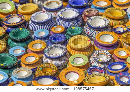 full frame background showing lots of colorful ashtrays