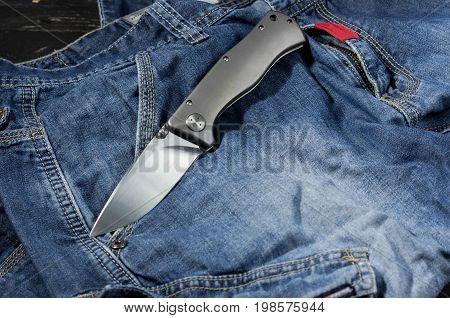 Folding Knife With Aluminum Handle. Knife In The Unfolded Position. Fron Side.