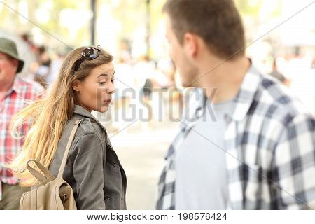 Sassy girl looking at a hot man bottom on the street