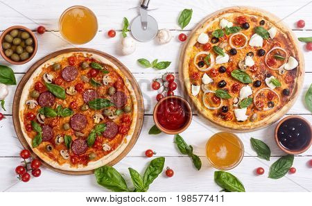 Italian pizza and ingridiend fod baking on table . Top view