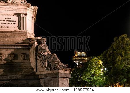Column of Pedro IV on Rossio Square, Pedro IV Square, Praca de D. Pedro IV in the city of Lisbon at night, in Portugal