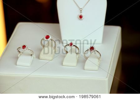 Classic Diamond engagement rings in a shop window red ruby with diamond halo