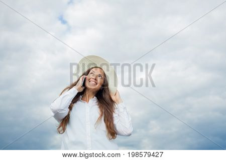 Beautiful Smiling Girl In A White Hat With A Wide Brim Talking On The Phone On Background Of Storm C