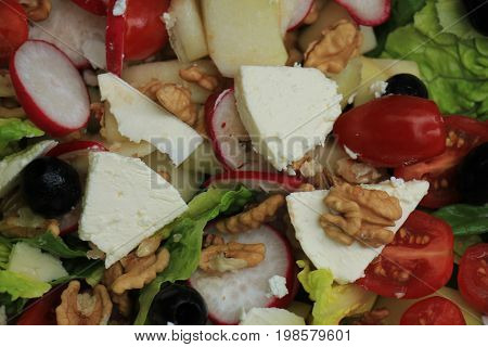 Mixed salad: goat cheese pear olives and walnuts