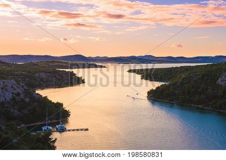 Sunset over the Estuary of Krka River and Lake Prokljan in Croatia, located near the cities of Skradin and Sibenik near Krka national park