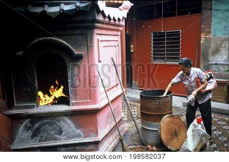 SINGAPORE / CIRCA 1990: A temple oven where worshipers may burn joss paper as offerings to their ancestors.