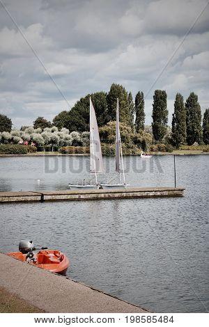 Two Sailboats Near Pier