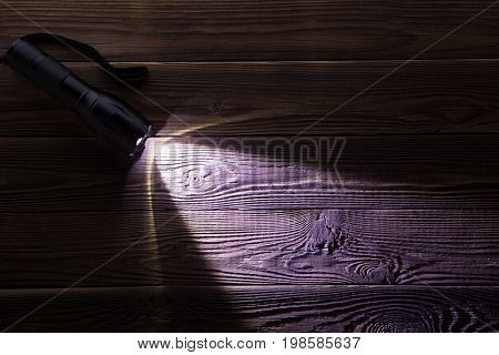 Wooden texture with glowing flashlight
