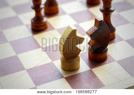Two Figures Of Horse. Wooden Chess Set On Chess Board. Chess. Black And White. Closeup