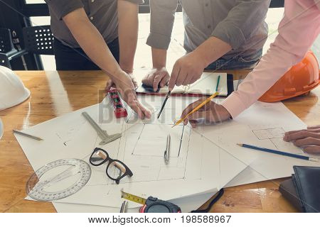 Engineer And Architect Concept, Engineer Architects Office Team Working And Discussing House Plan Wi