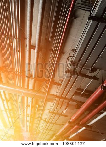 pipe line and electrical engineering pipe  red water pipe line and electrical electrical system in building, cable wiring. Mechanical engineering pipe. Electrical line. Communication cable.