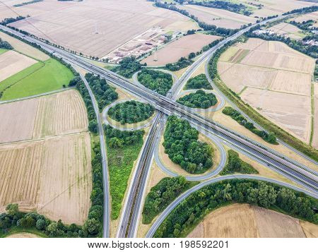 Aerial view of a highway intersection with a clover-leaf interchange
