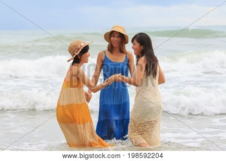 younger asian woman relaxing vacation time at sea beach happiness emotion