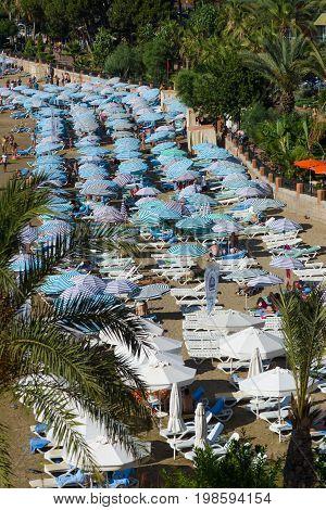AVSALLAR TURKEY - JUNE 30 2015: The coastline and relax on the beach. Anatolian coast - a popular holiday destination in summer of European citizens.