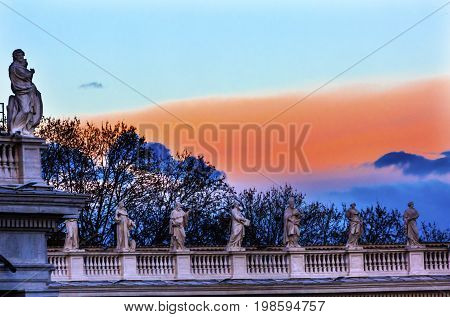 ROME, ITALY - JANUARY 18, 2017 Saints Statues Pink Blue Sunset Saint Peter's Roof Vatican Rome Italy.