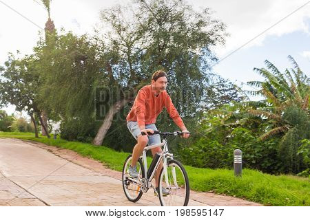 Young man with electric bicycle or E-bike.