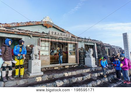 MOUNT FUJI YAMANASHI JAPAN - July 25 2017 : Lodge house and small shops on the summit of Mount Fuji. Fuji is highest mountain in Japan at 3776 m symbol of Japan