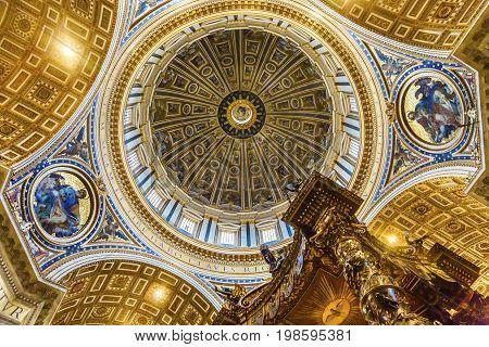 ROME, ITALY - JANUARY 18, 2017 Michelangelo Dome Baldacchino; Altar Saint Peter's Basilica Vatican Rome Italy. Dome built in 1600s over altar and St. Peter's tomb