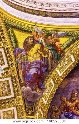 ROME, ITALY - JANUARY 18, 2017 Anthony The Abbott Basket Maker Angel Mosaic Saint Peter's Basilica Vatican Rome Italy. Mosaic right below Michaelangelo's Dome Created in 1600s over altar and St. Peter's tomb