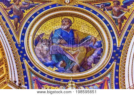 ROME, ITALY - JANUARY 18, 2017 Saint Luke Winged Ox Gospel Writer Evangelist Mosaic Angels Saint Peter's Basilica Vatican Rome Italy. Mosaic right below Michaelangelo's Dome Created in 1600s over altar and St. Peter's tomb