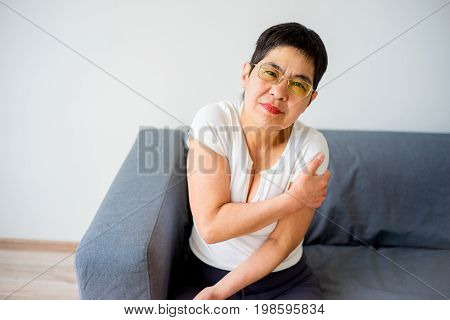 A portrait of a woman who sprained her arm