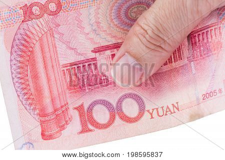 Detail of male hand holding hundred Chinese RMB banknotes on white background business and finance concept.