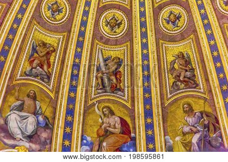 ROME, iTALY - JANUARY 8, 2017 Christ Saints Angels Mosaics Michelangeolo Dome Saint Peter's Basilica Vatican Rome Italy. Dome built in 1600s over altar and St. Peter's tomb