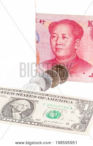 US dollar Chinese yuan banknote and Japanese yen coins on white background exchange rate concept.
