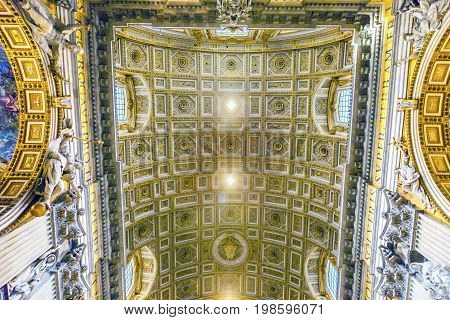 ROME, iTALY - JANUARY 8, 2017 Golden Ceiling Saint Peter's Basilica Vatican Rome Italy. Vatican built in 1600s over St. Peter's tomb