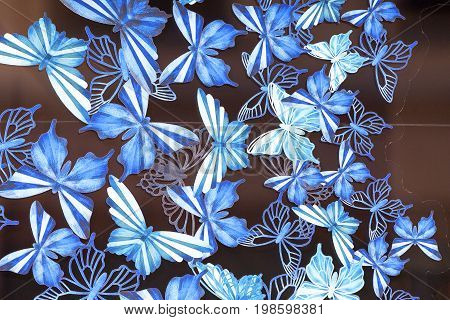 LONDON UNITED KINGDOM - JUNE 23 2017: Harrods luxury department store blue butterflies window decoration. 7-storey building built in 1905 has 330 departments covering 90000 m2 of retail space