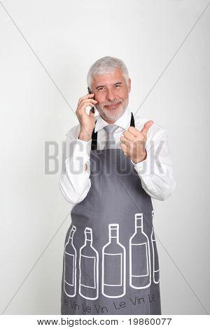 Wine waiter talking on the phone