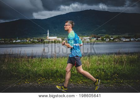 Lonely Man Leading A Group Of 10K Runners