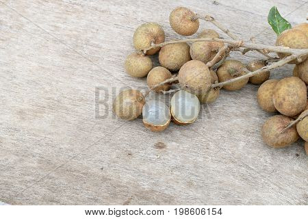 Longan Fresh. A Bunch Of Longan And Peel On A Wooden Background With Green Natural Background In The