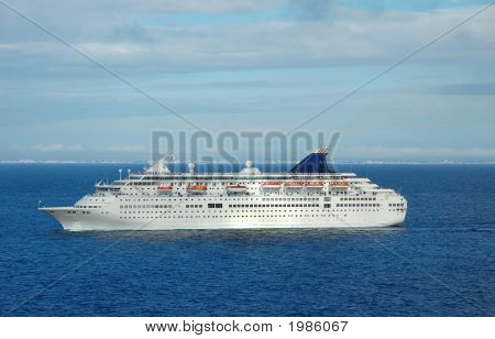 Luxury cruise liner approaching scenic caribbean destination poster