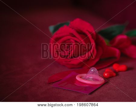 Low key of condom with red rose and hearts . Save sex Family plan and Valentine concept.