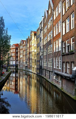 Scenic view of a canal with the building reflection in the water Amsterdam Holland Europe