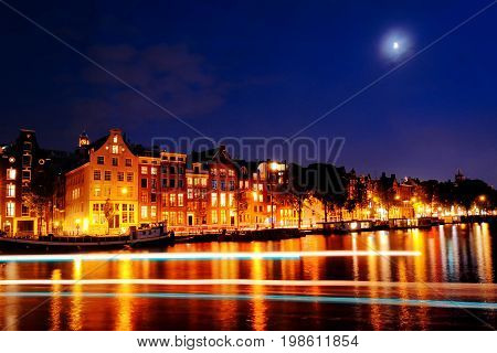 Scenic view of Amsterdam canal buildings and lights at night Netherlands Europe