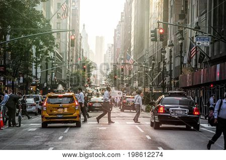 Lexington Crowdy Avenue In Manhattan At Around 5Pm On A Red Light Intersection. 5Pm With Sunset In T