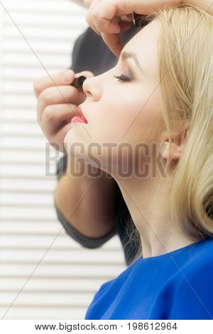 Woman Getting Mascara On Eyelashes By Visagiste With Brush