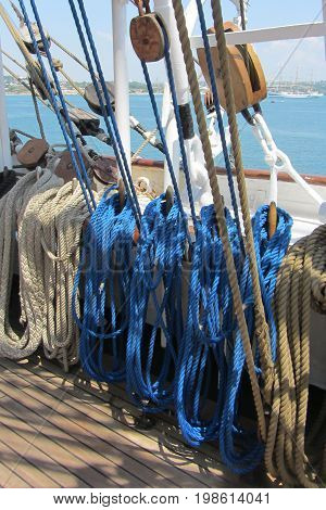 Blue sea ropes on the ship deck