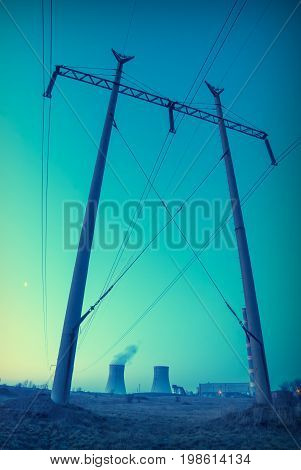 Sunset over the nuclear power plant. Vintage colors.