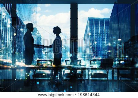 Handshake of two businessperson in a modern office. concept of partnership and teamwork