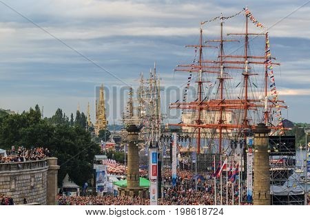 SZCZECIN, WEST POMERANIAN / POLAND - 2017: Final Tall Ships Races. Sailing ships at the waterfront and thousands of people at the concert