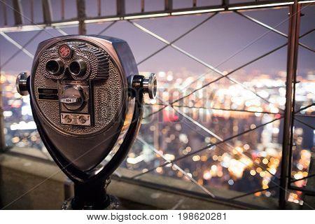 Binoculars On Top Of Empire State Building At Night In Manhattan, New York