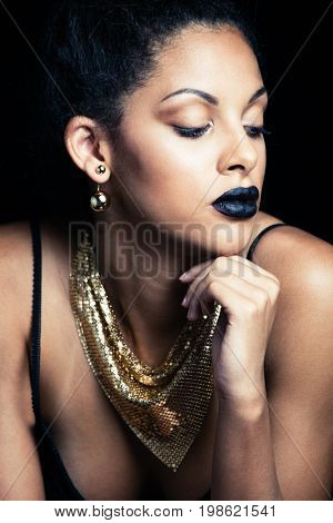 beauty portrait of a sensual glamorous young African woman with black lipstick studio shot