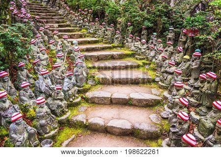 Miyajima Island, Hiroshima, Japan at the buddha lined pathways at Daisho-in Temple grounds. poster