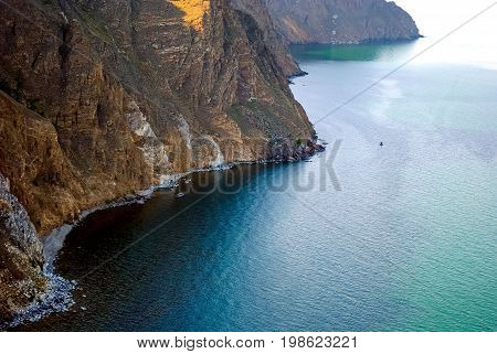 Baikal lake summer landscape, view from a cliff, Russia.