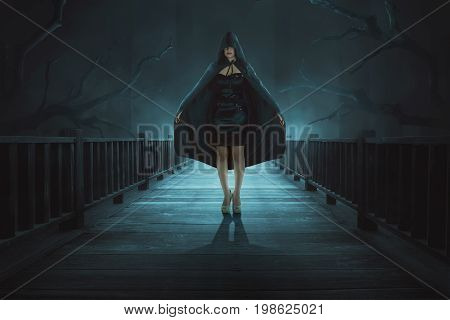 Portrait Of Mysterious Witch With Black Hooded Standing