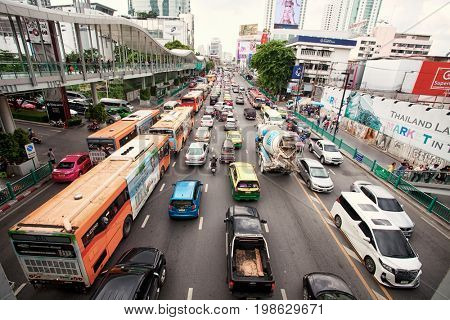 BANGKOK, THAILAND - JULY 30, 2017 : City scape traffic on front of Central world. Traffic moves slowly along a busy road in Bangkok,